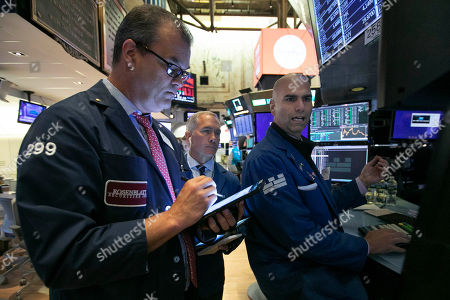 William Lawrence, Timothy Nick, Philip Finale. Traders William Lawrence, left, Timothy Nick, center, and specialist Philip Finale work on the floor of the New York Stock Exchange, . U.S. stocks moved lower in early trading on Wall Street Thursday after Netflix reported a slump in new subscribers and dragged down communications companies
