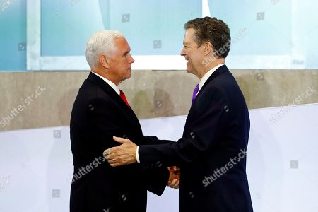 Mike Pence, Sam Brownback. Vice President Mike Pence, left, shakes hands with Sam Brownback, Ambassador at Large for International Religious Freedom, before speaking at the Ministerial to Advance Religious Freedom, at the U.S. State Department in Washington