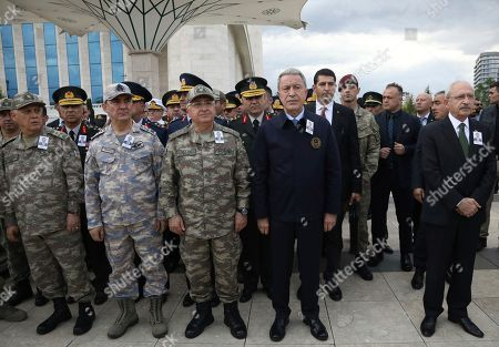 Hulusi Akar, Kemal Kilicdaroglu. Turkey's Defense Minister Hulusi Akar, second right, main opposition Republican People's Party leader Kemal Kilicdaroglu, right, and army's top commanders stand during the funeral prayers of Osman Kose, a 38-year-old Turkish diplomat killed in Iraq, in Ankara, Turkey, . A gunman opened fire inside a restaurant in the northern Iraqi city of Irbil on Wednesday, killing a Turkish diplomat working at Ankara's consulate, Turkey's state-run news agency and Iraqi media said