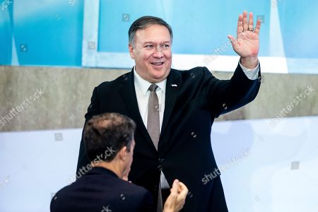 US Secretary of State Mike Pompeo (Back) waves beside US Ambassador-at-Large for International Religious Freedom Sam Brownback (Front) during the second Ministerial to Advance Religious Freedom, at the State Department in Washington, DC, USA, 18 July 2019. Delegations from around the world attend the meeting, to address challenges facing religious freedom, to identify persecution and promote religous liberty.