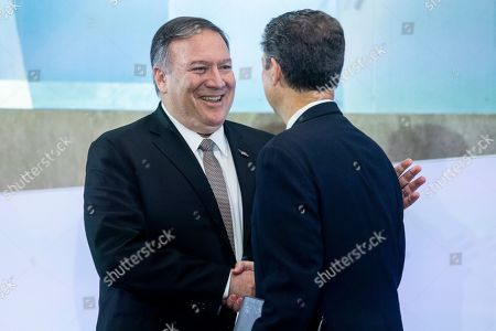 US Secretary of State Mike Pompeo (L) shakes hands with US Ambassador-at-Large for International Religious Freedom Sam Brownback (R) during the second Ministerial to Advance Religious Freedom, at the State Department in Washington, DC, USA, 18 July 2019. Delegations from around the world attend the meeting, to address challenges facing religious freedom, to identify persecution and promote religous liberty.