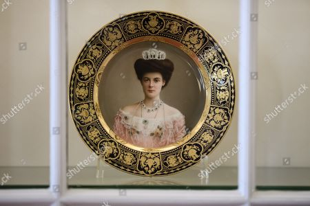 A view of a dinner plate depicting Duchess Cecilie of Mecklenburg-Schwerin at Cecilienhof Palace in Potsdam, Germany, 18 July 2019. Media reports that descendants of former German emperor Kaiser Wilhelm II from the House of Hohenzollern, led by Georg Friedrich Ferdinand Prince of Prussia, are claiming the right of residence for Cecilienhof Palace. Built from 1913 to 1917, the palace was home to Crown Prince William, the son of Kaiser Wilhelm II. Later it hosted the Potsdam Conference after the end of World War II. In July and August 1945, Winston Churchill, Harry S. Truman and Joseph Stalin literally reorganized the world from there. The claims of the House of Hohenzollern might end up in court, whereas the German Foundation Prussian Palaces and Gardens, which is running the museum Cecilienhof is planning a special exhibition for next year's 75th anniversary of the Potsdam Conference.
