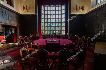 A view of the round table with the national flags of Great Britain, United States of America and the Soviet Union at the conference hall of Cecilienhof Palace in Potsdam, Germany, 18 July 2019. Media reports that descendants of former German emperor Kaiser Wilhelm II from the House of Hohenzollern, led by Georg Friedrich Ferdinand Prince of Prussia, are claiming the right of residence for Cecilienhof Palace. Built from 1913 to 1917, the palace was home to Crown Prince William, the son of Kaiser Wilhelm II. Later it hosted the Potsdam Conference after the end of World War II. In July and August 1945, Winston Churchill, Harry S. Truman and Joseph Stalin literally reorganized the world from there. The claims of the House of Hohenzollern might end up in court, whereas the German Foundation Prussian Palaces and Gardens, which is running the museum Cecilienhof is planning a special exhibition for next year's 75th anniversary of the Potsdam Conference.