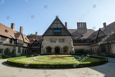 Stock Image of A view of the court yard at Cecilienhof Palace in Potsdam, Germany, 18 July 2019. Media reports that descendants of former German emperor Kaiser Wilhelm II from the House of Hohenzollern, led by Georg Friedrich Ferdinand Prince of Prussia, are claiming the right of residence for Cecilienhof Palace. Built from 1913 to 1917, the palace was home to Crown Prince William, the son of Kaiser Wilhelm II. Later it hosted the Potsdam Conference after the end of World War II. In July and August 1945, Winston Churchill, Harry S. Truman and Joseph Stalin literally reorganized the world from there. The claims of the House of Hohenzollern might end up in court, whereas the German Foundation Prussian Palaces and Gardens, which is running the museum Cecilienhof is planning a special exhibition for next year's 75th anniversary of the Potsdam Conference.