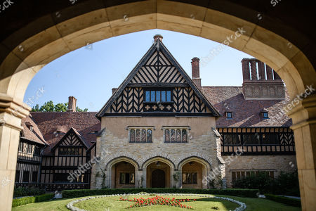 Stock Photo of A view of the court yard at Cecilienhof Palace in Potsdam, Germany, 18 July 2019. Media reports that descendants of former German emperor Kaiser Wilhelm II from the House of Hohenzollern, led by Georg Friedrich Ferdinand Prince of Prussia, are claiming the right of residence for Cecilienhof Palace. Built from 1913 to 1917, the palace was home to Crown Prince William, the son of Kaiser Wilhelm II. Later it hosted the Potsdam Conference after the end of World War II. In July and August 1945, Winston Churchill, Harry S. Truman and Joseph Stalin literally reorganized the world from there. The claims of the House of Hohenzollern might end up in court, whereas the German Foundation Prussian Palaces and Gardens, which is running the museum Cecilienhof is planning a special exhibition for next year's 75th anniversary of the Potsdam Conference.