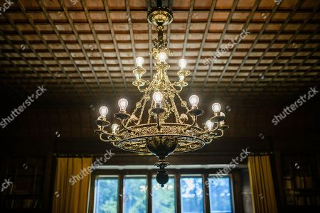 A view of a chandelier inside Cecilienhof Palace in Potsdam, Germany, 18 July 2019. Media reports that descendants of former German emperor Kaiser Wilhelm II from the House of Hohenzollern, led by Georg Friedrich Ferdinand Prince of Prussia, are claiming the right of residence for Cecilienhof Palace. Built from 1913 to 1917, the palace was home to Crown Prince William, the son of Kaiser Wilhelm II. Later it hosted the Potsdam Conference after the end of World War II. In July and August 1945, Winston Churchill, Harry S. Truman and Joseph Stalin literally reorganized the world from there. The claims of the House of Hohenzollern might end up in court, whereas the German Foundation Prussian Palaces and Gardens, which is running the museum Cecilienhof is planning a special exhibition for next year's 75th anniversary of the Potsdam Conference.