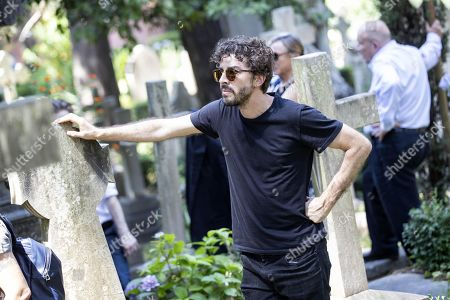 Italian actor Michele Riondino pays homage at the grave of late Italian writer Andrea Camilleri who was buried in the non-Catholic cemetery in Testaccio, Rome, Italy, 18 July 2019. Camilleri, who won loyal fans worldwide for his series of books about Sicilian Inspector Montalbano, has died at the age of 93 on 17 July 2019.