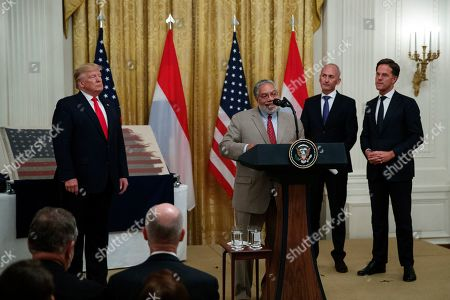 Lonnie Bunch, Donald Trump, Bert Kreuk, Mark Rutte. Lonnie Bunch, the New Secretary of the Smithsonian, joined by President Donald Trump, left, Dutch collector Bert Kreuk, second from right, and Dutch Prime Minister Mark Rutte, right, speaks during a ceremony in the East Room of the White House, in Washington. The 48-star flag flown on a U.S. Naval vessel during the D-Day invasion during was presented during the ceremony. The flag will be given to the Smithsonian's National Museum of American History. The vessel was control vessel Landing Craft, Control 60 (LCC 60