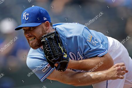 Kansas City Royals relief pitcher Ian Kennedy throws during the ninth inning of a baseball game against the Chicago White Sox, in Kansas City, Mo