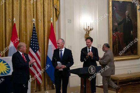Stock Photo of United States President Donald Trump, Dutch collector Bert Kreuk, Secretary of the Smithsonian Lonnie Bunch, and Prime Minister of the Netherlands Mark Rutte participate in a presentation of the D-DAY Flag ceremony in the East Room of the White House