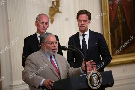 Dutch collector Bert Kreuk and Prime Minister of the Netherlands Mark Rutte listen to Secretary of the Smithsonian Lonnie Bunch speak at a presentation of the D-DAY Flag ceremony in the East Room of the White House