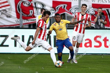 Bojan Cecaric (L) and Pelle van Amersfoort (R) of Cracovia in action against Eric Davis (C) of FC DAC 1904 Dunajska Streda during the 2019/20 UEFA Europa League first qualifying round, second leg soccer match between Cracovia and FC DAC 1904 Dunajska Streda in Krakow, Poland, 18 July 2019.