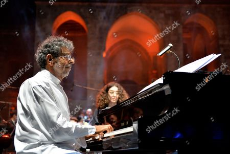 Gabriel Yared (L) and vocalist Yasmina Joumblatt (unseen) accompanied by the Lebanese Philharmonic Orchestra perform on stage at the opening night of the annual Beit Eddine Art Festival in Beiteddine, southeast of Beirut, Lebanon, 18 July 2019. The festival runs from 18 July to 10 August 2019.