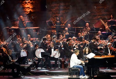 Gabriel Yared (C) accompanied by the Lebanese Philharmonic Orchestra perform on stage at the opening night of the annual Beit Eddine Art Festival in Beiteddine, southeast of Beirut, Lebanon, 18 July 2019. The festival runs from 18 July to 10 August 2019.