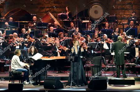 Gabriel Yared (C-L) and vocalist Yasmina Joumblatt (C) accompanied by the Lebanese Philharmonic Orchestra perform on stage at the opening night of the annual Beit Eddine Art Festival in Beiteddine, southeast of Beirut, Lebanon, 18 July 2019. The festival runs from 18 July to 10 August 2019.