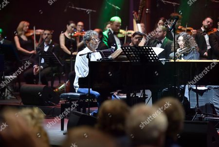 Gabriel Yared (C) and vocalist Yasmina Joumblatt (not pictured) accompanied by the Lebanese Philharmonic Orchestra perform on stage at the opening night of the annual Beit Eddine Art Festival in Beiteddine, southeast of Beirut, Lebanon, 18 July 2019. The festival runs from 18 July to 10 August 2019.