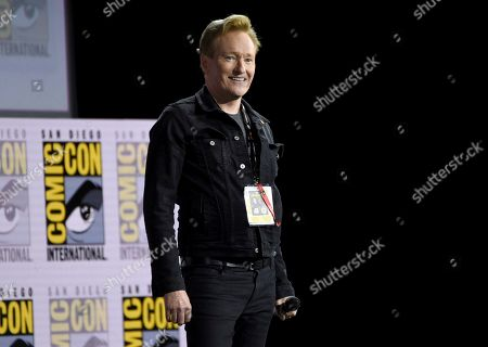 "Conan O'Brien introduces Tom Cruise to present a clip from ""Top Gun: Maverick"" on day one of Comic-Con International, in San Diego"