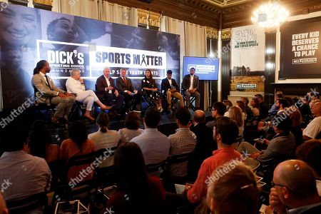 Stock Image of Jalen Rose, Jon Gruden. Oakland Raiders Head Coach Jon Gruden, center, moderates the panel on the importance of youth sports on behalf of The DICK'S Sporting Goods Foundation's Sports Matter program with panelists Larry Fitzgerald, from left, Dr. Marjorie Snyder, Edward W. Stack, Alex Morgan, Jordany Baltazar and Jalen Rose on in New York