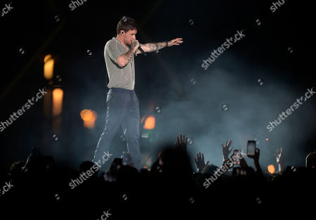 Stock Photo of Fans wave to Liam Payne as he performs at the King Abdullah Sports Stadium, in Jeddah, Saudi Arabia, during the concert of Jeddah World Fest, late . Janet Jackson, Chris Brown, 50 Cent, Future and Tyga have been added to the lineup for the concert in Saudi Arabia that Nicki Minaj pulled out of because of human rights concerns