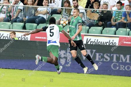 Artur Jedrzejczyk (R) of Legia Warszawa in action against Ibrahim Ayew (L) of Europa F.C. during the 2019/20 UEFA Europa League first qualifying round, second leg soccer match between Legia Warszawa and Europa F.C. from Gibraltar in Warsaw, Poland, 18 July 2019.