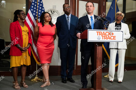 Stock Photo of Pennsylvania Attorney General Josh Shapiro, at podium, accompanied by Operation LIPSTICK Executive Director Tamia Rashima Jordan, left, Ebony LePenn, Philadelphia Council President Darrell Clarke and Dorothy Johnson-Speight, Founder and National Executive Director, Mothers in Charge, speaks during a news conference in Philadelphia