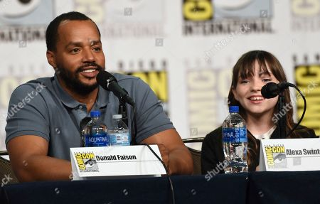 """Donald Faison, Alexa Swinton. Donald Faison, left, and Alexa Swinton participate in the """"Emergence"""" panel on day one of Comic-Con International, in San Diego"""