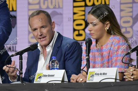 """Clark Gregg, Chloe Bennet. Clark Gregg, left, and Chloe Bennet participate in the """"Agents of S.H.I.E.L.D."""" panel on day one of Comic-Con International, in San Diego"""
