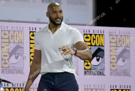 """Henry Simmons walks on stage at the """"Agents of S.H.I.E.L.D."""" panel on day one of Comic-Con International, in San Diego"""