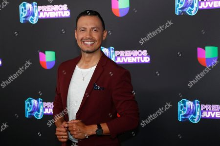 Mexican actor Luis Sandoval pose for a photo as he walks the red carpet before the Premios Juventud 2019, Latin awards show, in Coral Gables, Fla