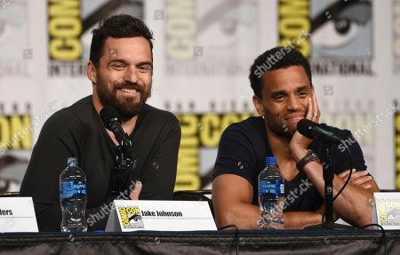 """Jake Johnson, Michael Ealy. Jake Johnson, left, and Michael Ealy participate in the """"Stumptown"""" panel on day one of Comic-Con International, in San Diego"""
