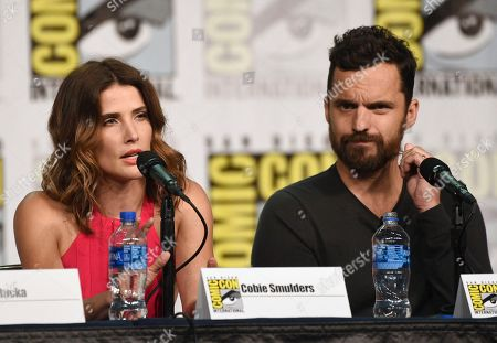 """Cobie Smulders, Jake Johnson. Cobie Smulders, left, and Jake Johnson participate in the """"Stumptown"""" panel on day one of Comic-Con International, in San Diego"""