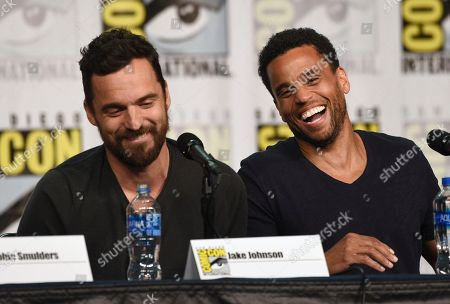 """Jake Johnson, Michael Ealy. Jake Johnson, left, and Michael Ealy attend the """"Stumptown"""" panel on day one of Comic-Con International, in San Diego"""