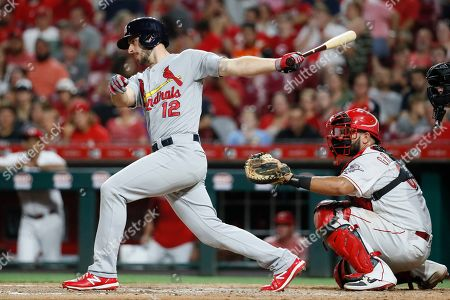 St. Louis Cardinals' Paul DeJong hits the game-tying RBI single off Cincinnati Reds relief pitcher Robert Stephenson in the sixth inning of a baseball game, in Cincinnati