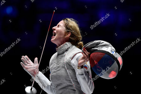 Gold medalist Inna Deriglazova of Russia celebrates defeating Pauline Ranvier of France in the women's individual foil final of the FIE World Fencing Championships in Budapest, Hungary, 19 July 2019.