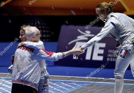 Inna Deriglazova of Russia celebrates with her coach after she deleated Pauline Ranvier of France (R) in the women's individual foil final of the FIE World Fencing Championships in Budapest, Hungary, 19 July 2019.