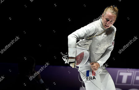 Silver medalist Pauline Ranvier of France looks on after losing to Inna Deriglazova of Russia in the women's individual foil final of the FIE World Fencing Championships in Budapest, Hungary, 19 July 2019.
