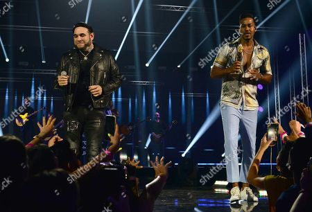 Frank Reyes and Romeo Santos perform on stage
