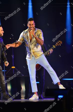 Frank Reyes and Romeo Santos