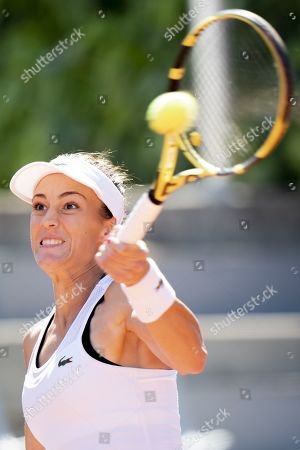 Stock Picture of Bernarda Pera from USA returns a ball to Xinyun Han from China during their quarter final match at the WTA International Ladies Open Lausanne tournament, in Lausanne, Switzerland, 19 July 2019.
