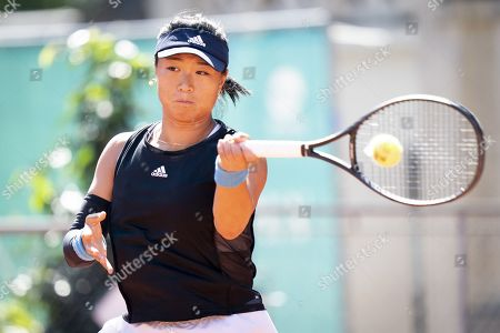 Xinyun Han from China returns a ball to Bernarda Pera from USA during their quarter final match at the WTA International Ladies Open Lausanne tournament, in Lausanne, Switzerland, 19 July 2019.