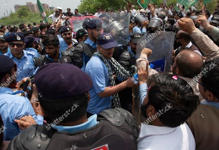 Stock Picture of Supporters of Pakistan Muslim League confront with police near an accountability court where former Prime Minister Shahid Khaqan Abbasi and Maryam Nawaz, daughter of arrested former premier Nawaz Sharif, appear in Islamabad, Pakistan, . Authorities in Pakistan arrested Abbasi Thursday over alleged irregularities related to the import of natural gas from Qatar