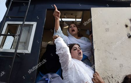 Arrested Pakistan Muslim League supporters shout anti-government chants near an accountability court where Pakistan former Prime Minister Shahid Khaqan Abbasi and Maryam Nawaz, daughter of arrested former premier Nawaz Sharif appear in Islamabad, Pakistan, . Authorities in Pakistan arrested Abbasi Thursday over alleged irregularities related to the import of natural gas from Qatar