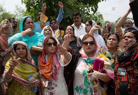 Pakistan Muslim League workers shout anti-government slogans near an accountability courts where former Prime Minister Shahid Khaqan Abbasi and Maryam Nawaz, daughter of arrested former premier Nawaz Sharif appear in Islamabad, Pakistan, . Authorities in Pakistan arrested Abbasi Thursday over alleged irregularities related to the import of natural gas from Qatar