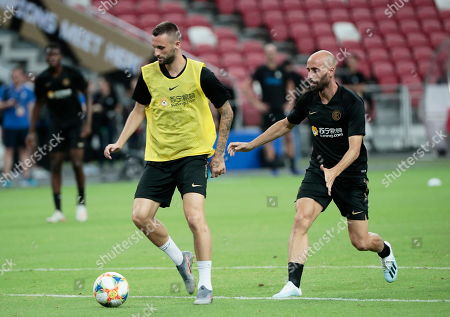 Inter's Marcelo Brozovic (L) and Borja Valero (R) attend a training session at the National Stadium in Singapore, 19 July 2019. Inter Milan faces Manchester United in an International Champions Cup match on 20 July 2019.