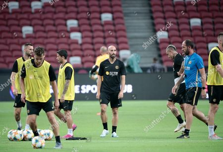 Stock Image of Inter's Borja Valero (C) attends a training session at the National Stadium in Singapore, 19 July 2019. Inter Milan faces Manchester United in an International Champions Cup match on 20 July 2019.