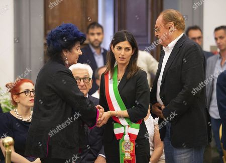 (L-R) Italian actress Marisa Laurito, Rome Mayor Virginia Raggi and Italian showmaster and singer Renzo Arbore pay tribute to Italian writer Luciano De Crescenzo as his coffin is laid in state at the City Hall in Rome, Italy, 19 July 2019. Author, director, actor and TV host Luciano De Crescenzo died in Rome on 18 July at the age of 90. Others are not identified.