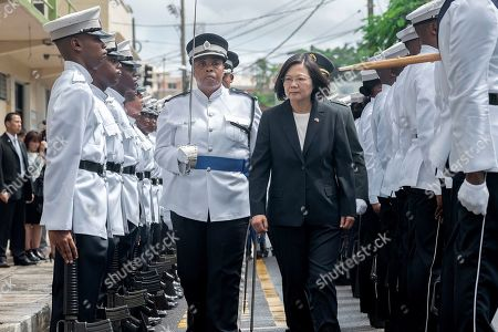"""In this photo released by the Taiwan Presidential Office, Taiwanese President Tsai Ing-wen attends a welcome ceremony in St. Lucia on . Tsai said she would follow """"humanitarian principles"""" in dealing with asylum seekers from Hong Kong during a visit this week to Saint Lucia, an eastern Caribbean island nation that is among Taiwan's few remaining allies"""