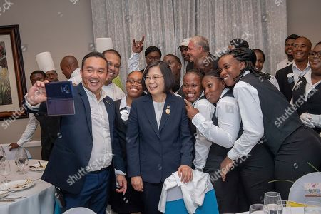 """In this photo released by the Taiwan Presidential Office, Taiwanese President Tsai Ing-wen poses for photos in St. Lucia on . Tsai said she would follow """"humanitarian principles"""" in dealing with asylum seekers from Hong Kong during a visit this week to Saint Lucia, an eastern Caribbean island nation that is among Taiwan's few remaining allies"""