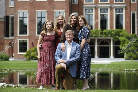 Dutch King Willem-Alexander (C) poses with (L-R) Princess Ariane, Princess Catharina-Amalia, Queen Maxima and Princess Alexia during the annual royal photo session in the garden of Huis ten Bosch Palace in The Hague, Netherlands, 19 July 2019. Huis ten Bosch is one of three official residences of the Dutch royal family.