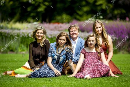 Stock Image of (L-R) Dutch Queen Maxima, Princess Alexia, King Willem-Alexander, Princess Ariane and Princess Catharina-Amalia pose during the annual royal photo session in the garden of Huis ten Bosch Palace in The Hague, Netherlands, 19 July 2019. Huis ten Bosch is one of three official residences of the Dutch royal family.